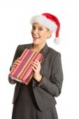 Woman weating Santa hat and holding a present — Stock Photo