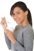 Side view healthy woman eating yoghurt — Stock Photo