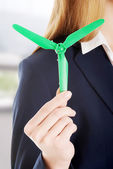 Beautiful business woman with green propeller. — Stock Photo