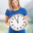 Woman holding a big clock — Stock Photo #61743567