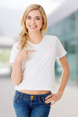 Woman with pink breast cancer ribbon — Stock Photo