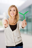 Woman with led light bulb and windmill — Stock Photo