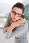 Woman with shoulder pain — Stock Photo