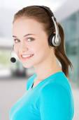 Call center assistant smiling — Stock Photo