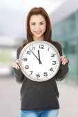 Happy woman holding office clock — Stock Photo