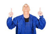 Repairman pointing up with both hands — Foto de Stock