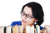 Woman searching for  book — Stock Photo