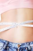 Woman measuring her waistline — Stock Photo