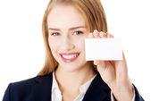 Beautiful smiling businesswoman with businesscard — Stock Photo