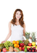 Young woman with group of fruit. — Stock Photo