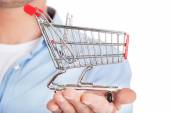 Man with a small shopping basket. — Stock Photo
