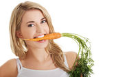 Young woman with the carrots — Stock Photo