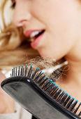 Woman loosing hair — Stock Photo