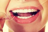 Young woman with dental floss. — Stock Photo