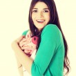 Young woman holding piggy-bank. — Stock Photo #62600707