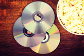 Picture of popcorn in a bowl and CDs. — Stock Photo