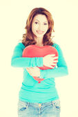 Attractive woman holding a baloon heart. — Stock Photo