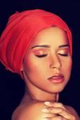 Attractive womans head in turban. — Stock Photo