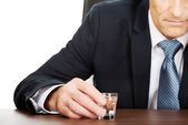 Overworked man drinking vodka in office — Foto Stock
