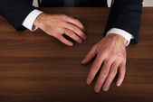 Businessman's hands put on the desk — Stock Photo