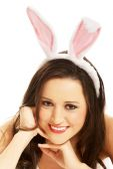 Portrait of beautiful woman wearing bunny ears — Stock Photo