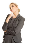 Businesswoman thinking about an idea — Stock Photo