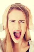 Beautiful woman screams and covers her ears. — Stock Photo