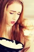 Depressed woman eating big bowl of ice creams — Stock Photo