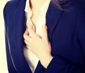 Beautiful business woman touching her chest. — Foto de Stock