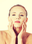 Beautiful woman with collagen mask on face. — Stock Photo
