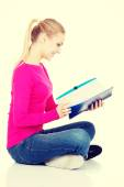 Young student woman with workbook. — Stock Photo