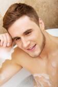 Handsome man taking a bath. — Stock Photo