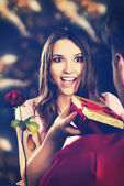 Woman recieving a gift. — Stock Photo