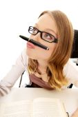 Woman with pen on mouth — Stock Photo
