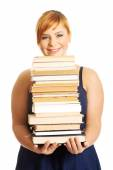 Woman holding books — Stock Photo