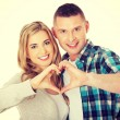 Couple  gesturing heart shaped sign — Stock Photo #64946015