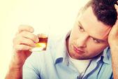 Man drinking whisky — Stock Photo