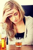 Yound woman in depression, drinking alcohol — Stock Photo