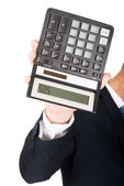 Businessman's hand with calculator — Stock Photo