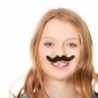 Young woman with a moustache — Stock Photo #66933525