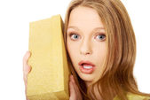 Woman shaking the gift box — Stock Photo