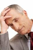Stressed and tired businessman — Stock Photo