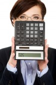 Businesswoman with SOS writing on calculator. — Foto de Stock
