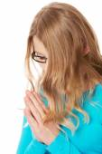 Young sad woman praying holding clasp hands — Stock Photo