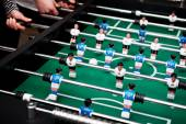 Friends playing table football. — Stockfoto