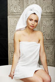 Beautiful woman sitting on bathtub. — Stock Photo