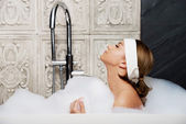 Bathing woman relaxing in bath. — Stock Photo