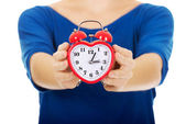 Young woman holding alarm clock. — Stock Photo