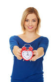 Woman with a clock. — Stock Photo