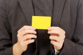 Business woman with empty card. — Stock Photo